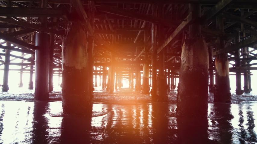 Walking under pier in slow motion 120fps  | Shutterstock HD Video #1052643518