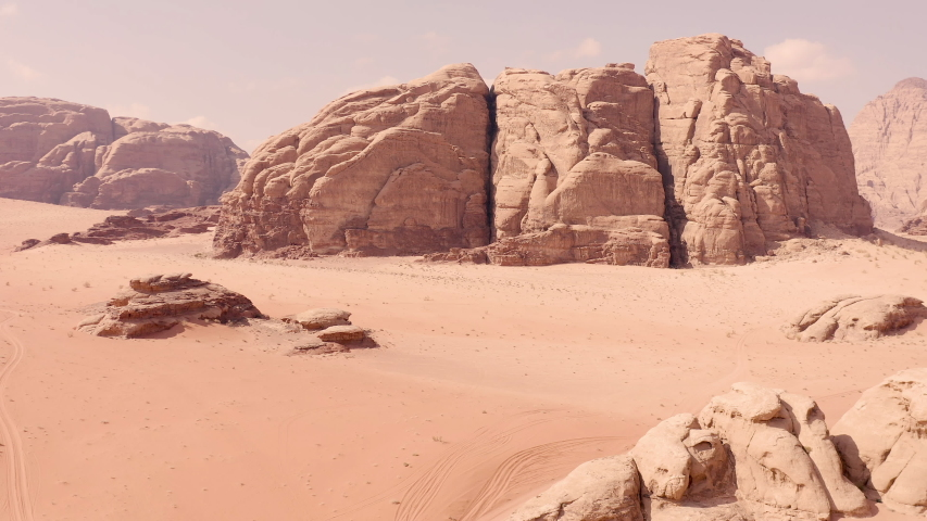 Wadi Rum desert with the Mushroom Rock Area, in Jordan. | Shutterstock HD Video #1052668880