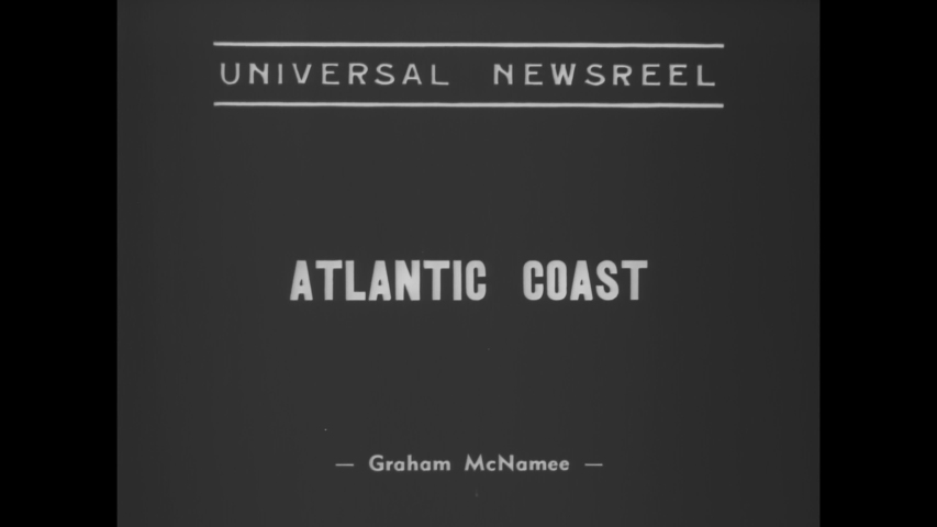 CIRCA 1938 - The Atlantic Coast is hit by a hurricane, causing flooding and damage to buildings, boats, and cars.