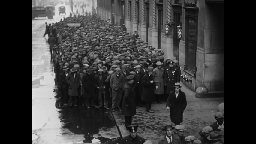 CIRCA 1930 - Poor men receive bread and soup on a breadline in an American city during the Great Depression.