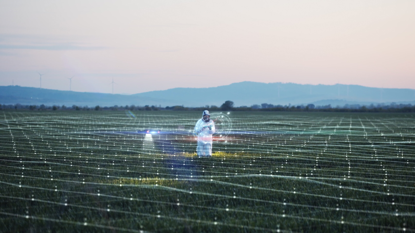 Futuristic concept of engineer using hologram panel scanning farm land. Drone analyzes the field. Smart agriculture animation, internet of things. Industrial revolution. Future technology | Shutterstock HD Video #1052689496