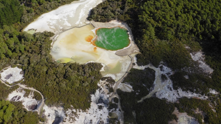 Aerial view of Wai-O-Tapu, Thermal Wonderland in Rotorua, New Zealand. Drone flight. | Shutterstock HD Video #1052690918