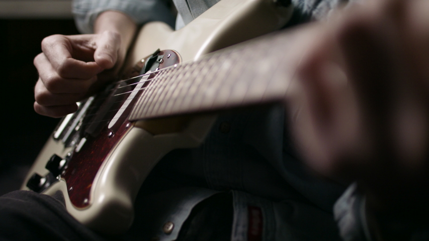Musician playing the guitar during a live performance. Shot on RED camera in 4k. | Shutterstock HD Video #1052695055