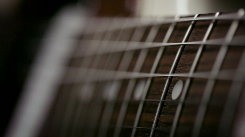 Playing the guitar. Strumming electric guitar. A musician plays music. Shot on RED camera in 4k. | Shutterstock HD Video #1052695382