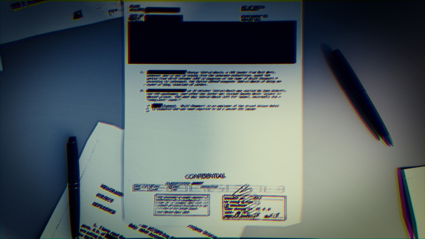 Top Secret concept background. Mystery documents of fbi or cia on a grey table and shadows playing on it. Royalty-Free Stock Footage #1052713064