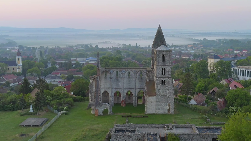 Amazing aerial 4k vedeo about the Premontre Monastery. This is a church ruin in Zsambek city Hungary. Built in 1220-1234.  Roman and gotchic style. Destroyed an big earthquake in 1763.  | Shutterstock HD Video #1052719301