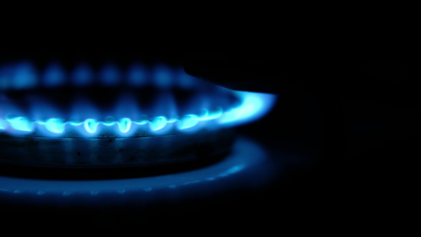 Turning on the cooktop gas cooker on black background. Kitchen burner turning on. Close up on the flame. Natural gas inflammation in stove burner, close up view. Gas burning from a kitchen gas stove | Shutterstock HD Video #1052721473