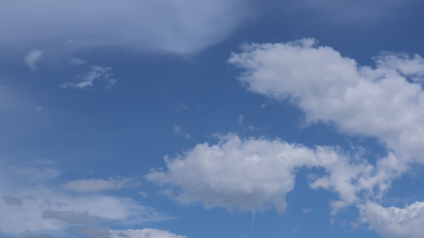 Time lapse of beautiful blue sky with clouds background.Sky clouds.Sky with clouds weather nature cloud blue.Blue sky with clouds and sun. | Shutterstock HD Video #1052722460