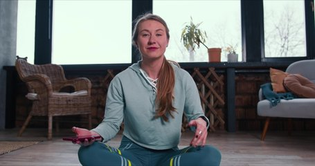 Happy beautiful cheerful sporty fitness coach woman talking to camera leading fitness classes on webcam video from home.