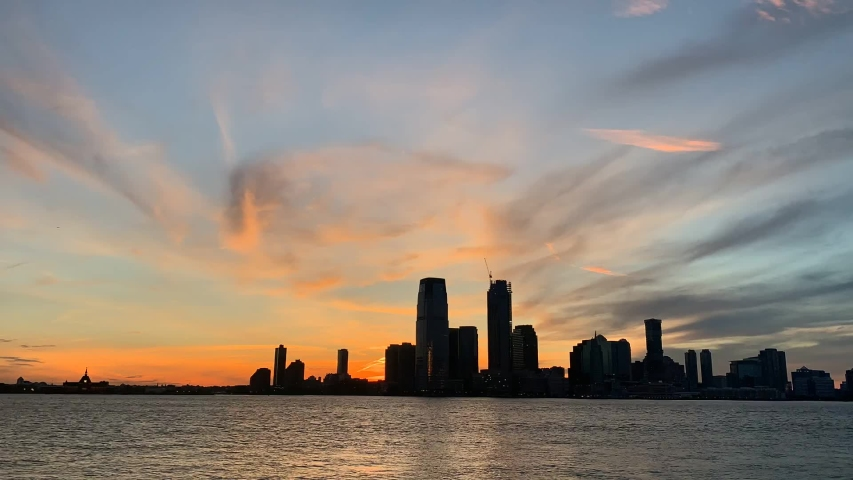 Short timelapse of a sunset going over a cityscape by the water, which was taken at Wagner Park in New York City.