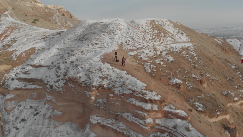 Amazing landscape footage of Red Valley with its spectacular rock formations located in Cappadocia, Turkey.   Shutterstock HD Video #1052727083