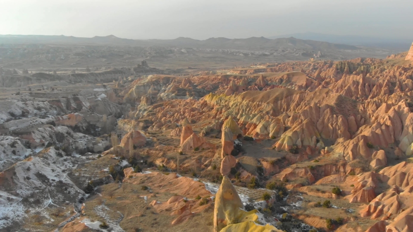 Amazing landscape footage of Red Valley with its spectacular rock formations located in Cappadocia, Turkey.   Shutterstock HD Video #1052727095