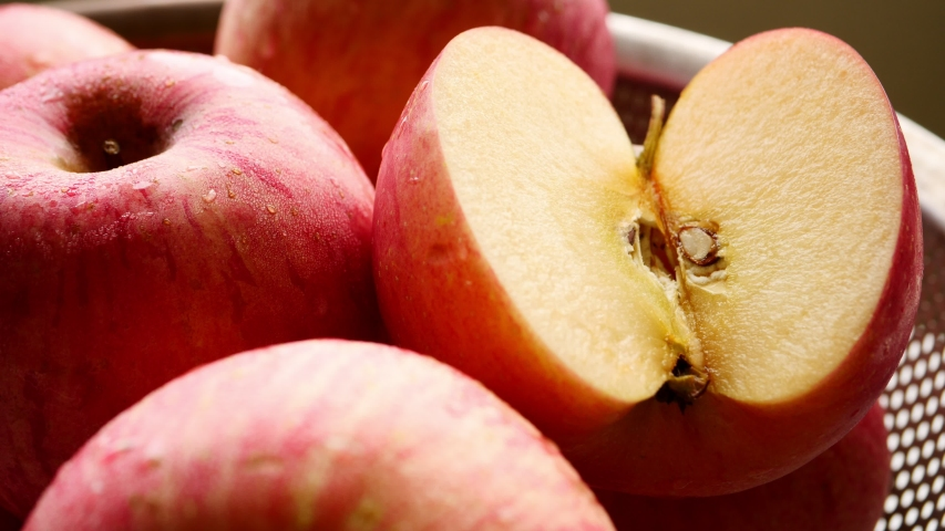 Close up of fresh red apples in the basket. | Shutterstock HD Video #1052728505
