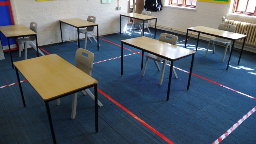 4K: Empty Classroom with Tape on the floor between desks for Social Distancing to prevent the spread of COVID-19 Coronavirus in Education. Crane Shot. Stock Video Clip Footage Royalty-Free Stock Footage #1052737556