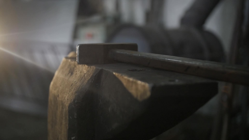 A hammer lighted by lamp on anvil in smithy. Slow motion.  | Shutterstock HD Video #1052741879