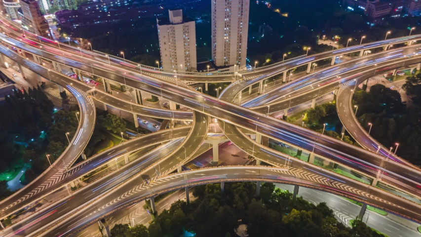 4K Hyper lapse Rising Drone Shot View Reveals Spectacular Elevated Highway and Convergence of Roads, Bridges, Viaducts in Shanghai Night, Transportation and Infrastructure Development China Timelapse. Royalty-Free Stock Footage #1052743382