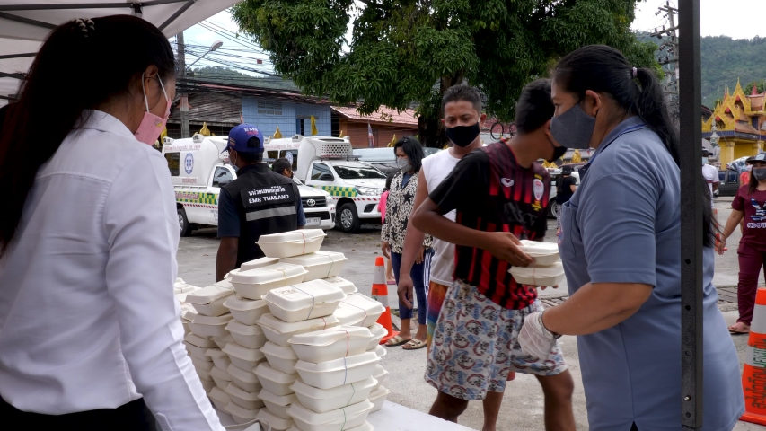 Koh Samui, Thailand - April 24, 2020: Food donations on Island during Covid-19 outbreak. Group of volunteers