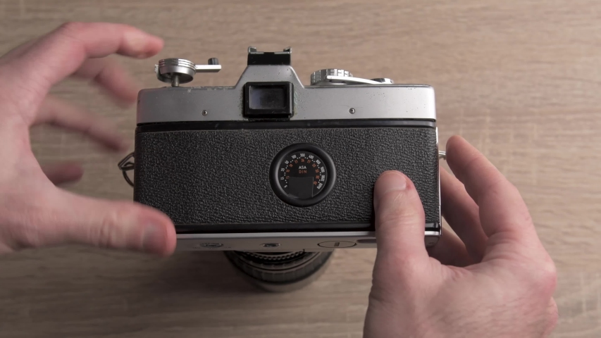 Educational video showing the internal functioning of the manual roll of film rewind system of a mechanical old analog photography camera Royalty-Free Stock Footage #1052750927