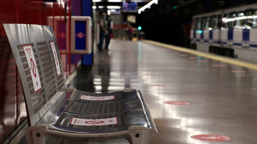 A Madrid METRO seat marked with stickers so that travelers maintain the minimum safety distance between them due to the state of alarm in Spain by COVID-19. Filmed on May 19, 2020.