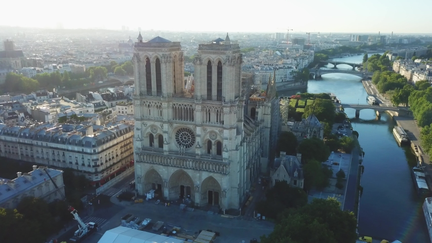 France, Paris. Aerial drone view to the Notre-Dame de Paris after the roof caught tragic fire. Renovation work. French Gothic architecture   Shutterstock HD Video #1052755307