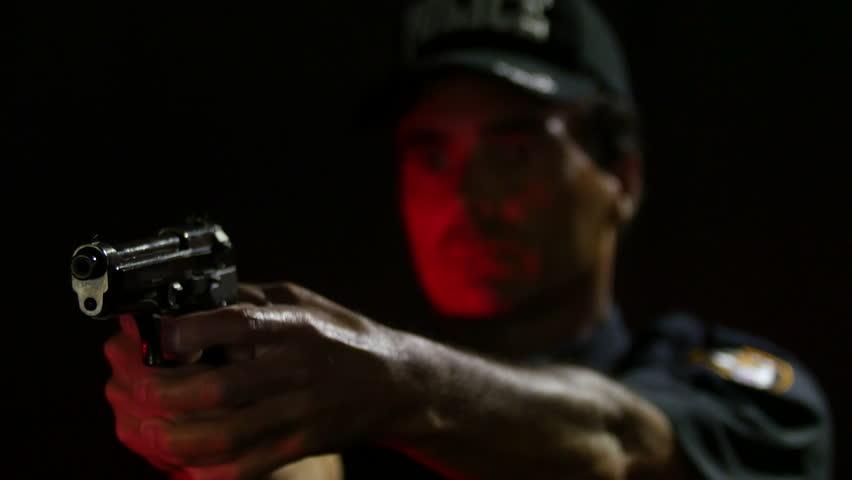 Police Officer firing a gun, close up of the gun   Shutterstock HD Video #10527704