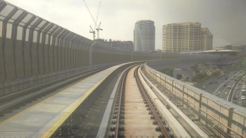 KUALA LUMPUR, MALAYSIA -JULY 8, 2019: Passengers record the Mass Rapid Transit (MRT)ement from the back of the train. It looks like the train is leaving the destination. | Shutterstock HD Video #1052770997