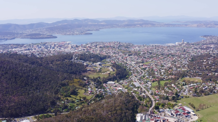 High aerial of Hobart city scape, CBD, ports and harbour, Derwent River, looking east