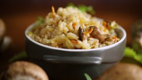 vegetarian cooked rice with mushrooms in a ceramic bowl