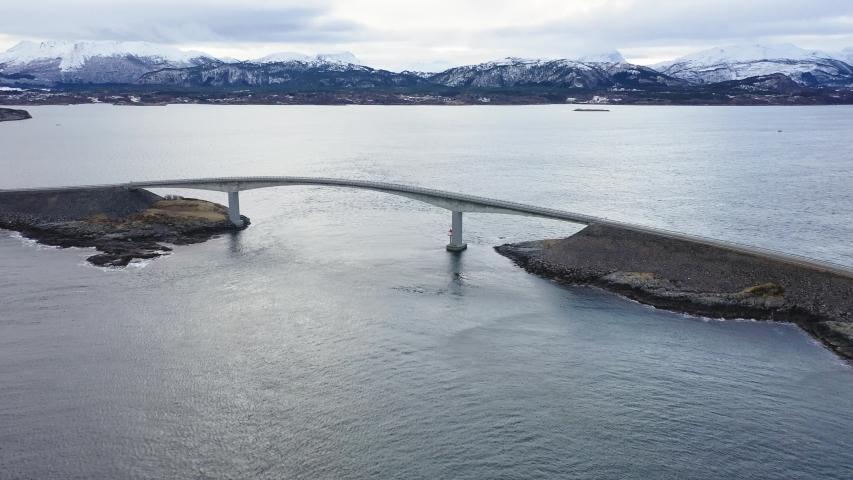 Winter atlantic road in Norway. Aerial view from a bird's flight. Storseisendet Bridge