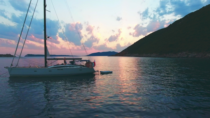 Beautiful calm sunset with only one yacht on the sea | Shutterstock HD Video #1052809598