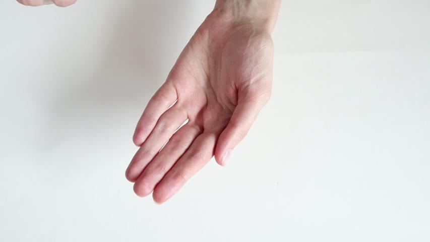 Closeup of woman`s hands using an alcohol antibacterial hand sanitizer. Clean hands hygiene corona virus  prevention. | Shutterstock HD Video #1052819381