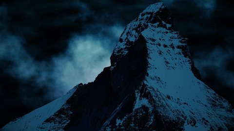 A beautiful snow-capped mountain on a foggy night with stars shining brightly.