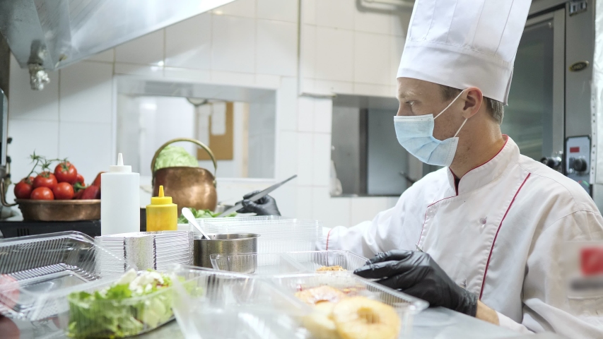 Food delivery in the restaurant. The chef prepares food in the restaurant and packs it. Panna cotta and vegetable salad in a plastic disposable containers