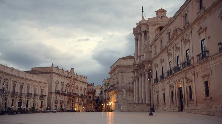 Empty square of Ortigia island in province Siracusa in Sicily at early cloudy sunrise   Shutterstock HD Video #1052826821