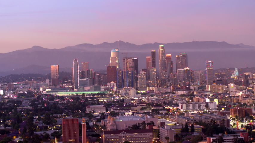Downtown Los Angeles aerial view, business centre of the city in dawn, sunset in California, mountains in a background of skyscrapers | Shutterstock HD Video #1052837570