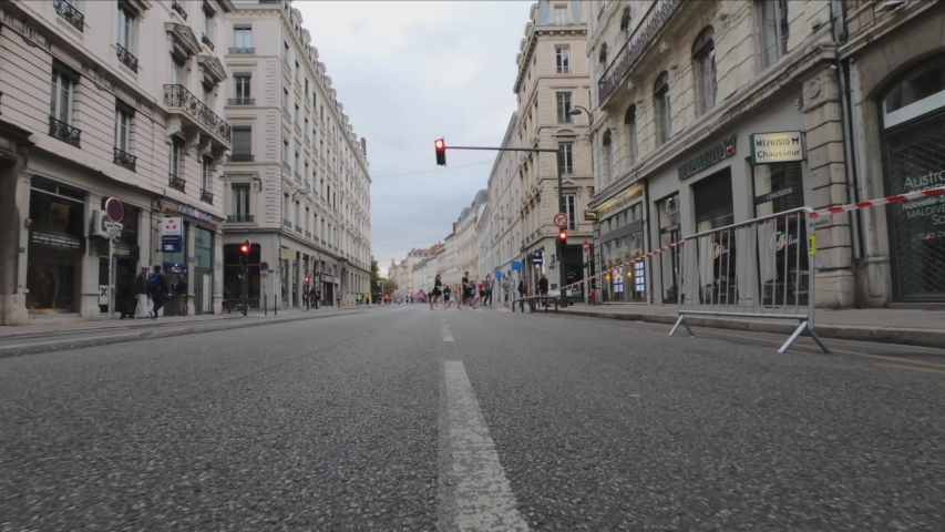 Lyon / France - October 6, 2019: DOLLY SHOT -  Rue Antoine de Saint-Exupéry street. Run In Lyon 2019 Finish Line at the Place Bellecour in the background.  | Shutterstock HD Video #1052841098