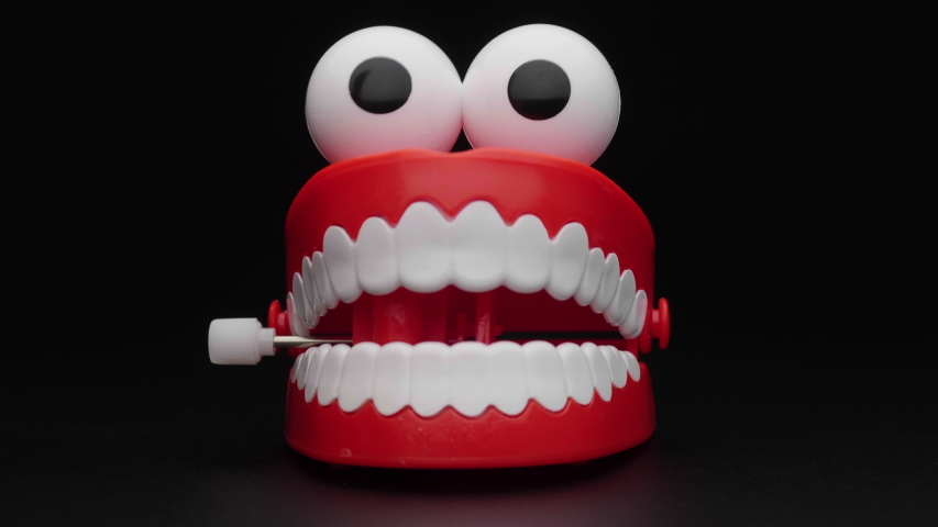 Toy teeth. Moving funny tooth model toy. | Shutterstock HD Video #1052848610