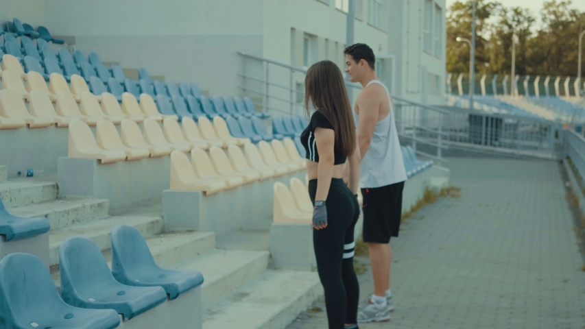 Attractive young latin couple is engaged in the fresh air. jumping stairs | Shutterstock HD Video #1052855816