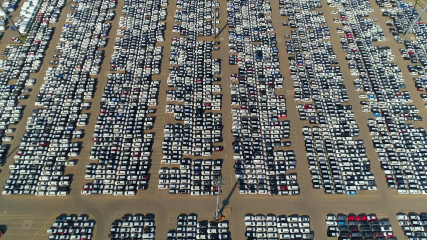 Aerial forward. Large parking many new cars distribution center of modern seaport. Logistics supplies automotive industry. Export import storage. Delivery to car dealers. Metropolis epic parking. 4k