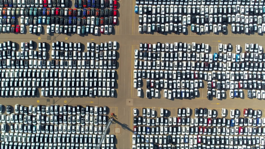 Many cars largest huge parking in seaport port. Automaker car automotive industry. Development marketing selling of vehicles. Logistics transit. Petersburg Europe best. Flight top down abstract