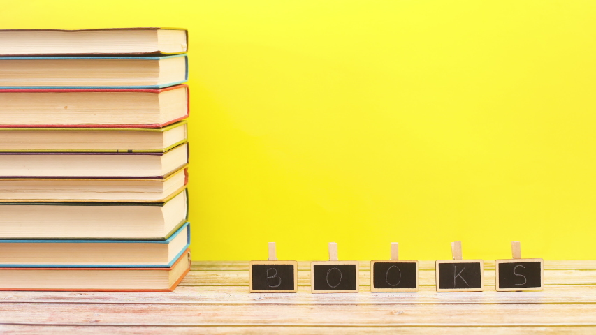 Books title moving on boards on table with books ordered on left side - Stop motion   Shutterstock HD Video #1052867657