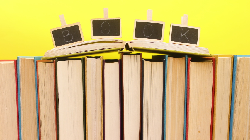 Books ordering and title books appear on open book - Stop motion   Shutterstock HD Video #1052867678