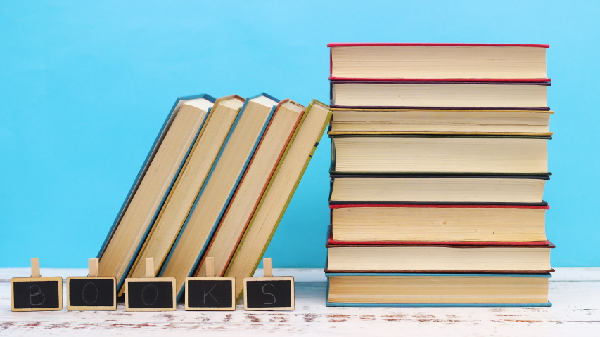 Pile of ordered books and books title on little boards - Stop motion   Shutterstock HD Video #1052868056