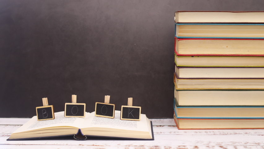 Book title moving on opened book - Stop motion   Shutterstock HD Video #1052868062