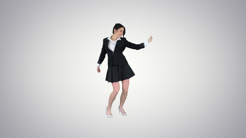 Dancing brunette businesswoman walking in, stops in the middle and then goes away on gradient background. | Shutterstock HD Video #1052870888