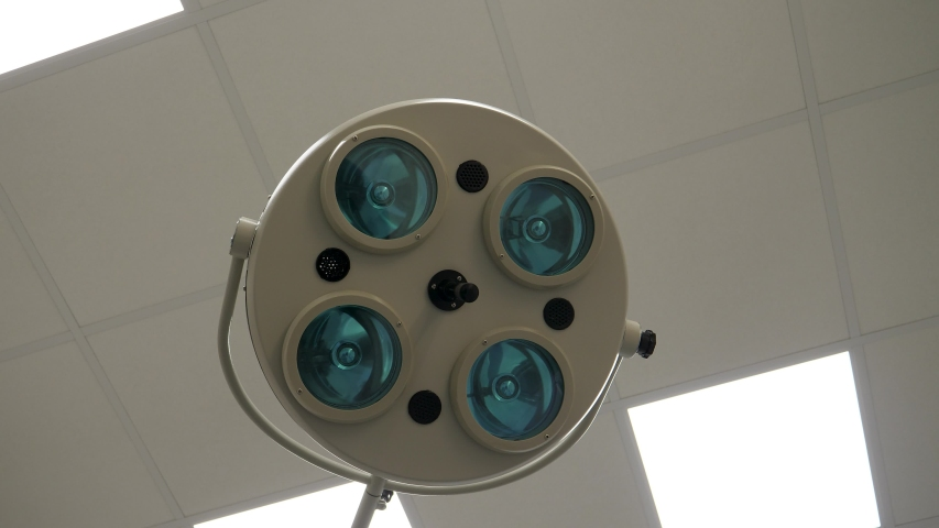 The medical lamp turns off and we see light and momentum