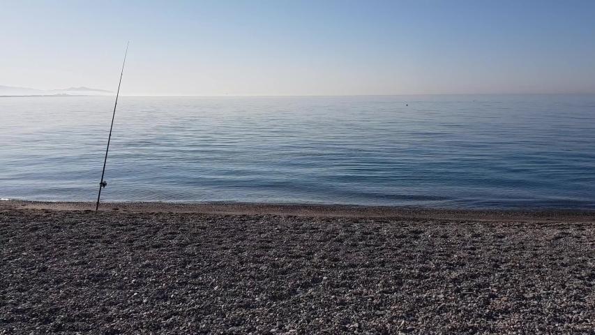 Fishing rod on the shore early in the morning. Velilla in Almuñecar, Granada, Andalusia, Spain. | Shutterstock HD Video #1052875298
