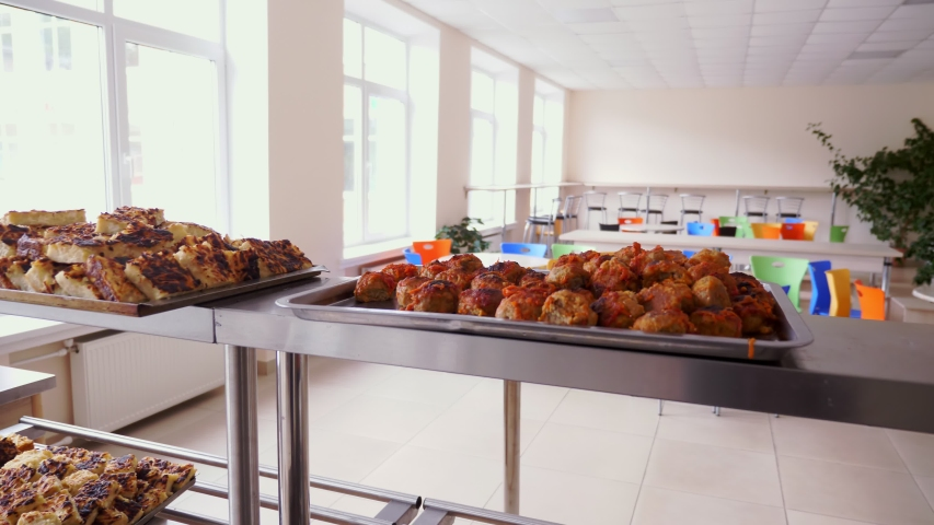 In canteen, free hot meals are showcased. volunteers prepare Charity food for poor and homeless people . Charity project, donating aid, food delivery   Shutterstock HD Video #1052876267