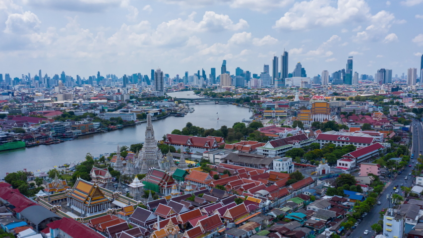 Aerial hyperlapse video of Wat Arun and Bangkok city along Chaophraya river, Thailand. The video is shaking due to camera shake, motion blur, overuse of noise reduction.   Shutterstock HD Video #1052878364