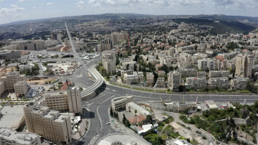 Jerusalem on  coronavirus Lockdown, Chords bridge and main Entrance-Aerial Drone view over empty streets due to government restrictions.- April-15-2020- drone   | Shutterstock HD Video #1052880623